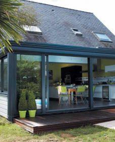 Prix veranda rideau esthete – veranda sur maison pierre